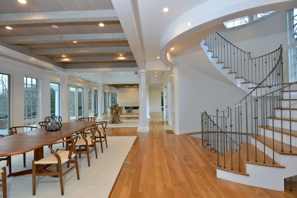 Interior image of Newport Rhode Island waterfront home with dining room and staircase